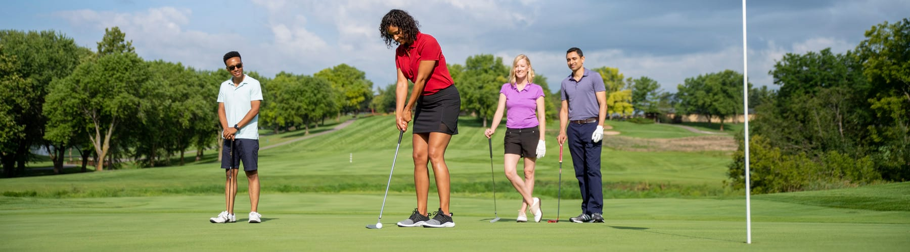 Four golfers on the green