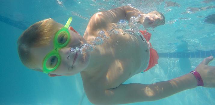 Boy swimming under