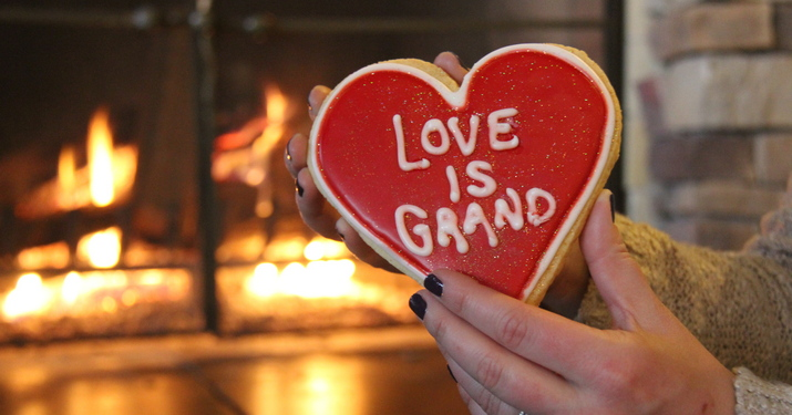 Love is Grand on a cookie with fire blazing in background