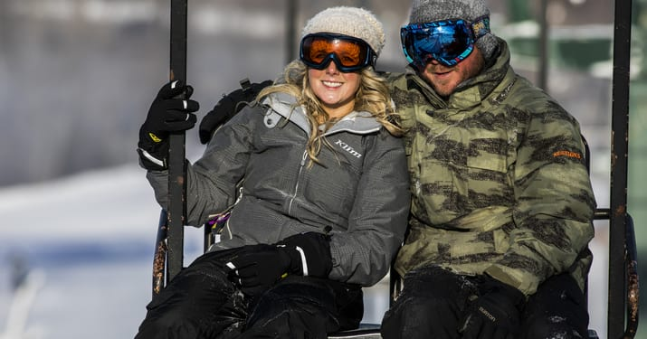 Skier couple on chairlift