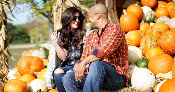 Couple sitting on the pumpkin throne