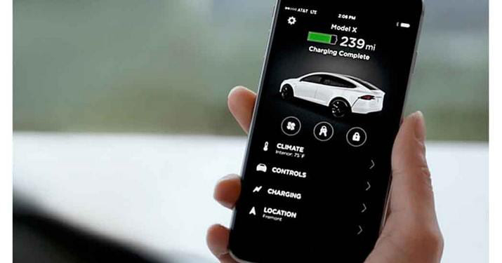 Cell phone showing Tesla Car fully charged