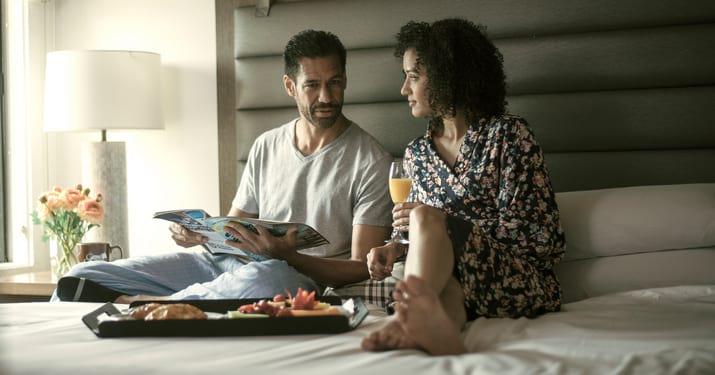 Couple enjoying coffee in bed
