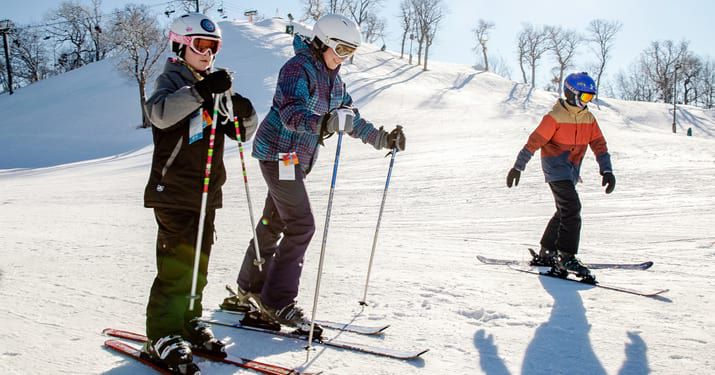 Skiers at The Mountain Top