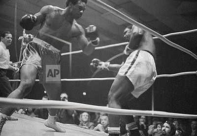 Still from the 1971 boxing match between George Foreman and Ernie Terrell