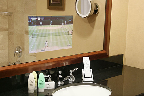 Photo of bathroom sink with with Seura television mirror