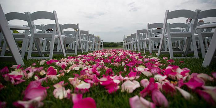 Wedding flowers down aisle at Grand Geneva